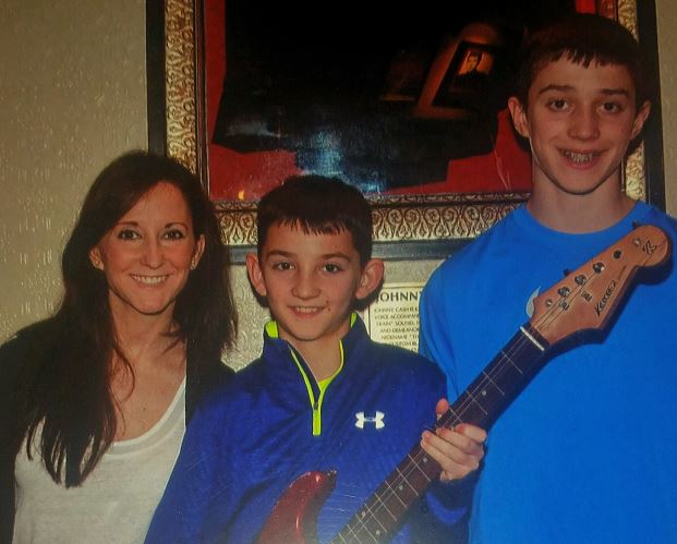 Cheryl Hatfiled and her sons, cropped