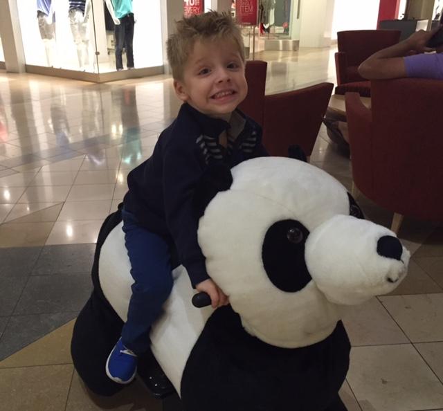 Boy on panda at NWA Mall, Fayetteville