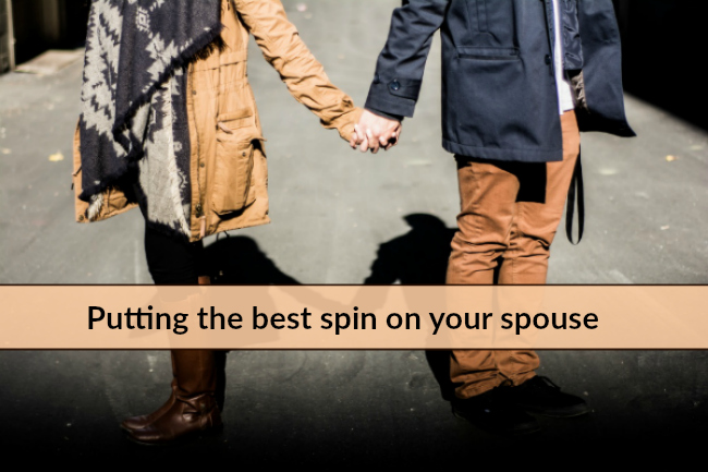 couple holding hands spin on spouse