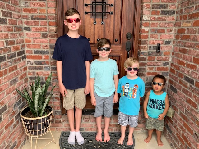 Photo of Allison Smith's four sons standing on the front porch