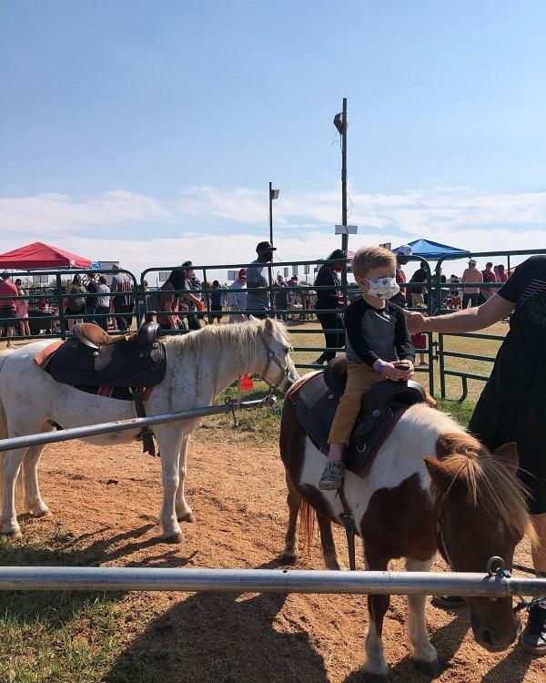 April Wallace, Farmland, riding a pony